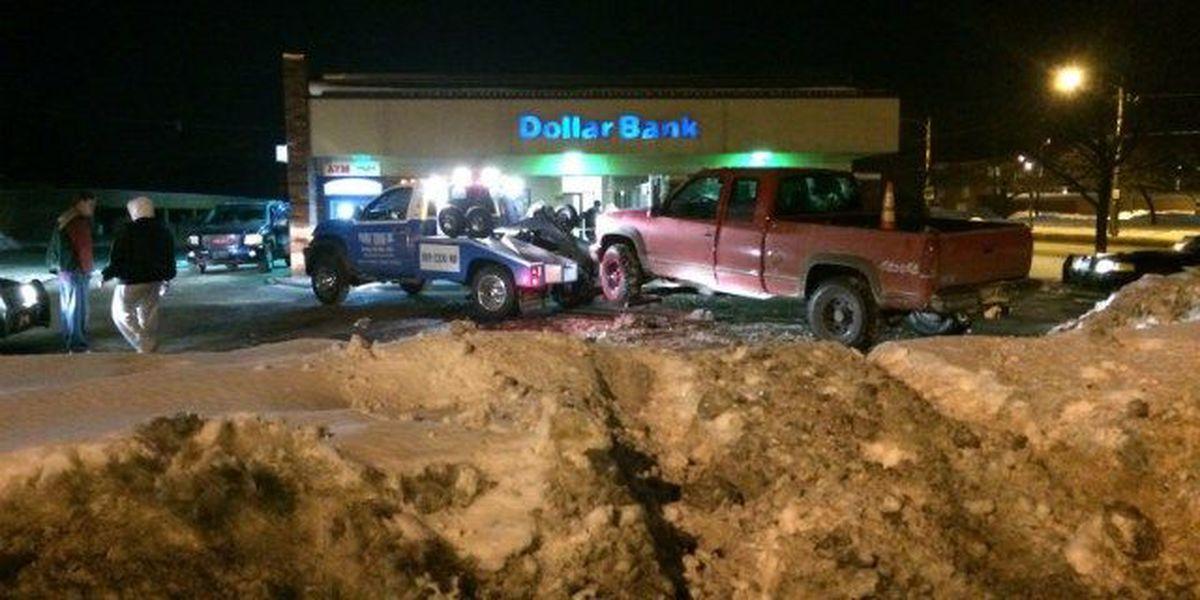 Truck hits snowbank, crashes into Cleveland bank