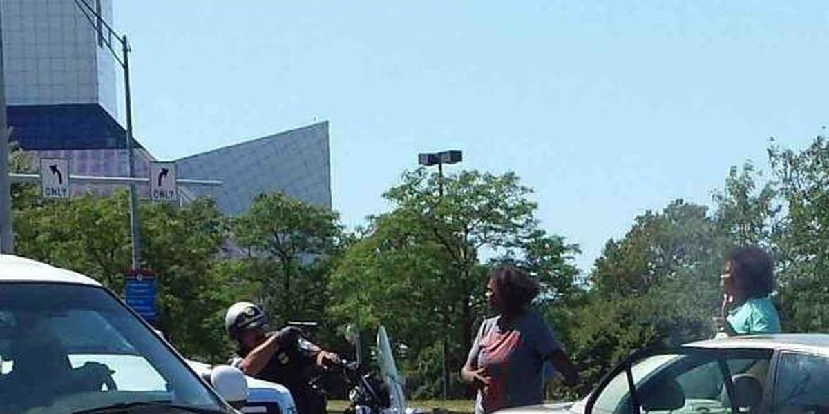 Story behind viral photo showing Cleveland police pulling his weapon on motorists