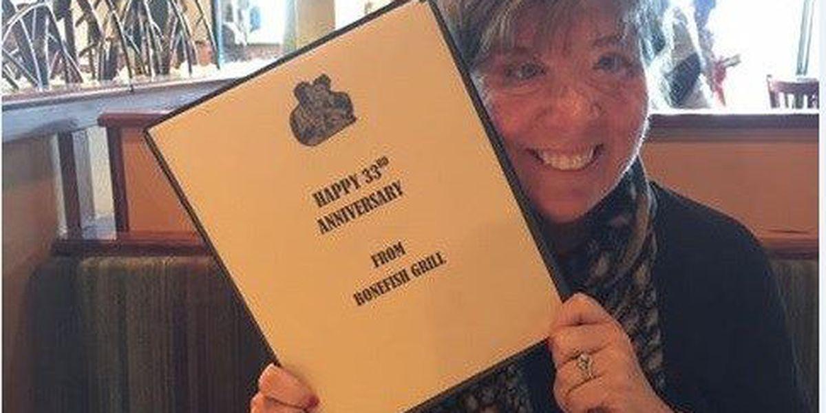 Sharon Budd smiles while celebrating anniversary