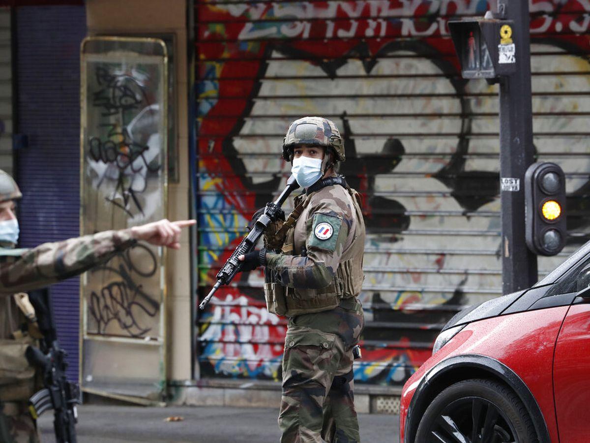 Terror probe opened after 2 stabbed in Paris; 2 arrests