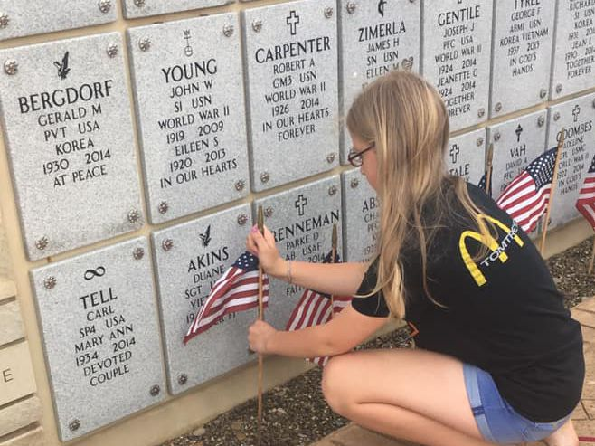 Mother, daughter spend hours fixing American flags blown away from storm at Ohio Western Reserve National Cemetery