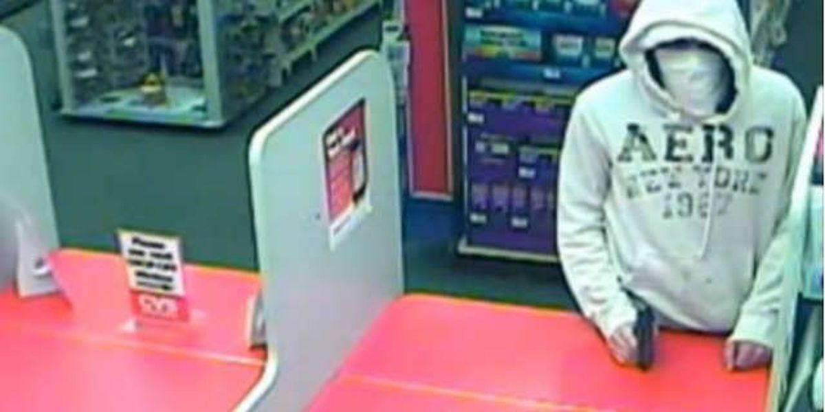 Police: Man robs pharmacy at gunpoint, suspect caught on tape