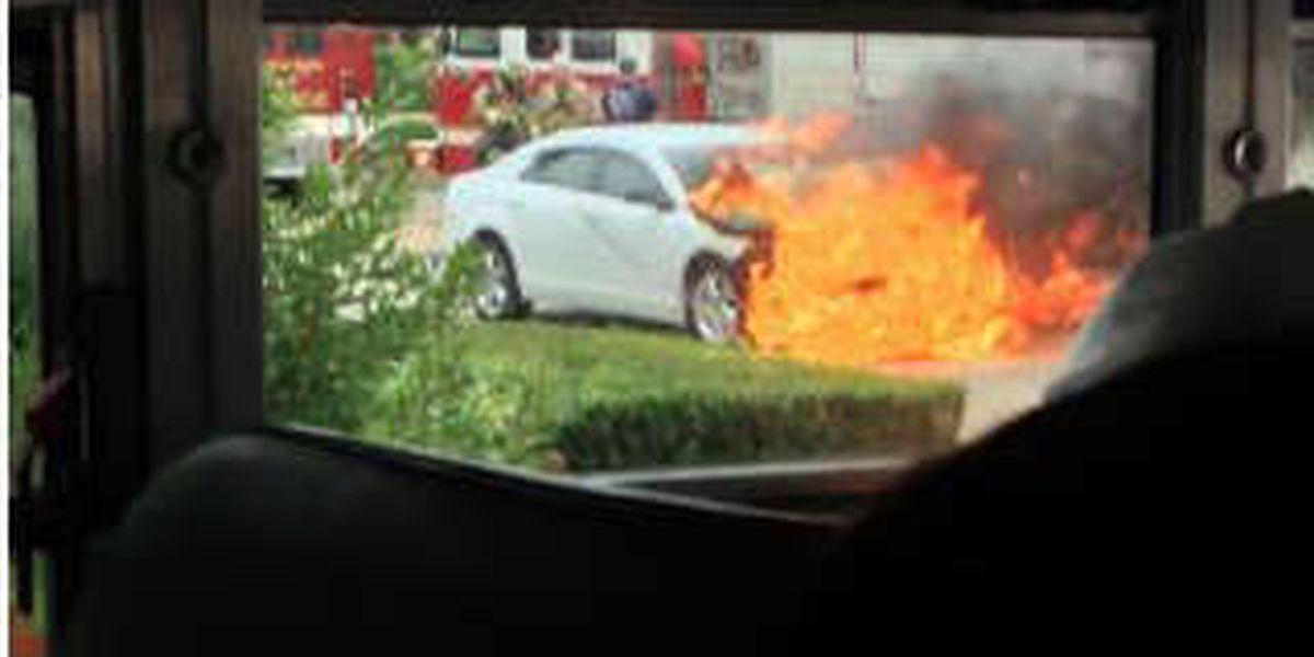 Bus VS. car crash has fiery ending