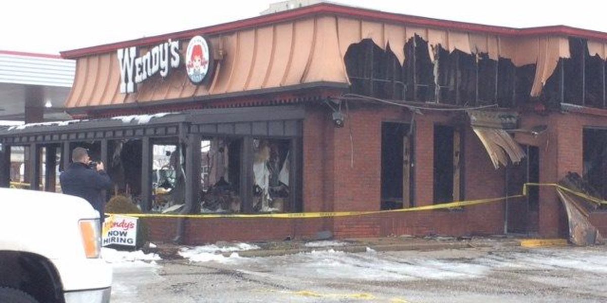 Firefighters deal with icy conditions while battling fire at the Stow Wendy's