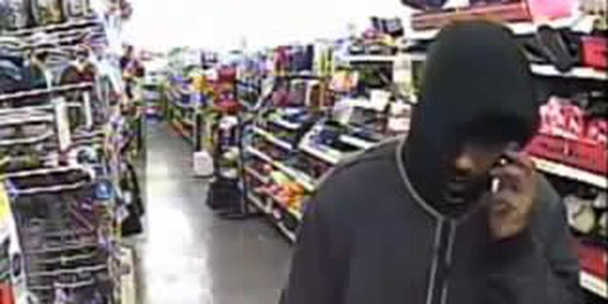 PHOTOS: Armed suspect robs Akron Dollar General