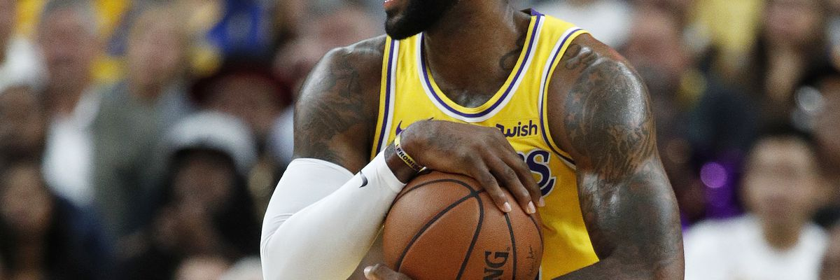 LeBron James hits buzzer-beater three-point shot against Golden State Warriors