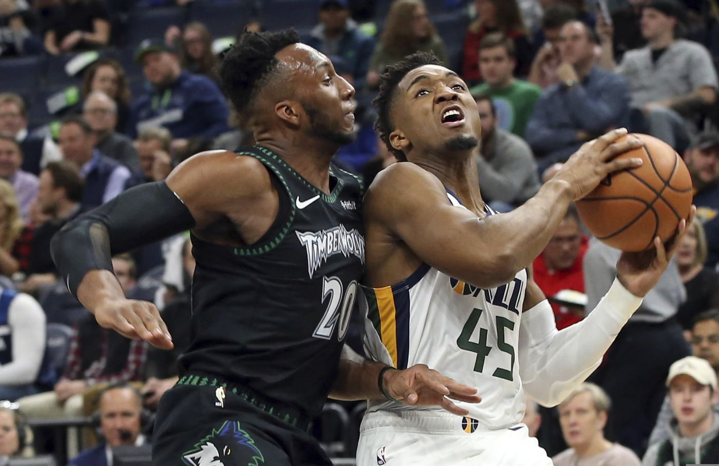 3a3a8232 Utah Jazz's Donovan Mitchell, right, eyes the basket while Minnesota  Timberwolves' Josh Okogie