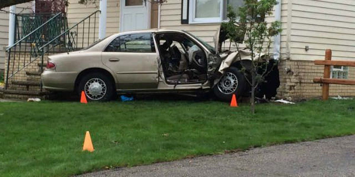 Driver hospitalized after car crashes into house