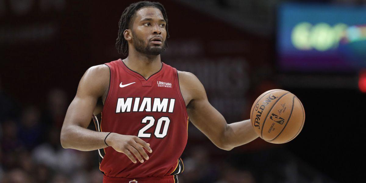 Winslow scores 27, leads Heat past Cavaliers 100-94