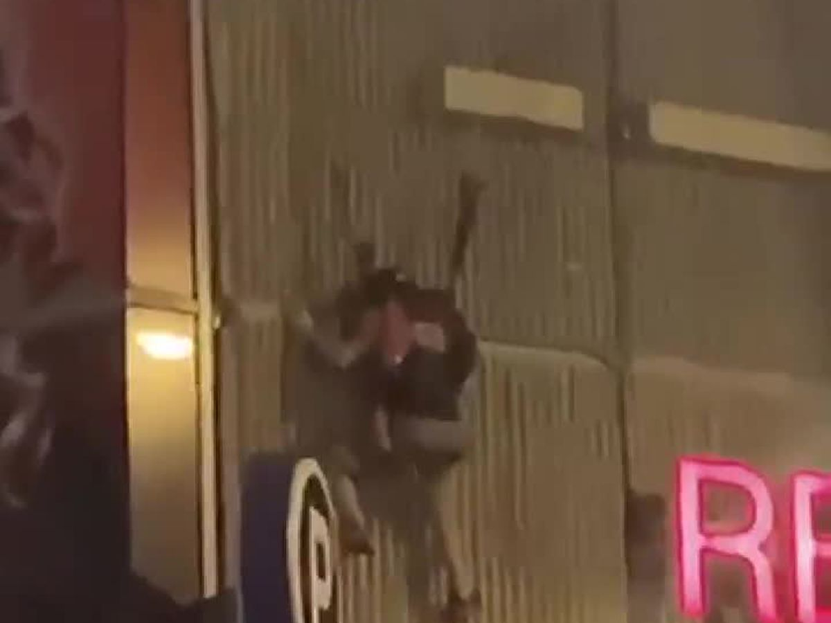 Witness couldn't believe his eyes, as man breaks his leg base jumping off an apartment roof and crashing into 19 News station (graphic video)
