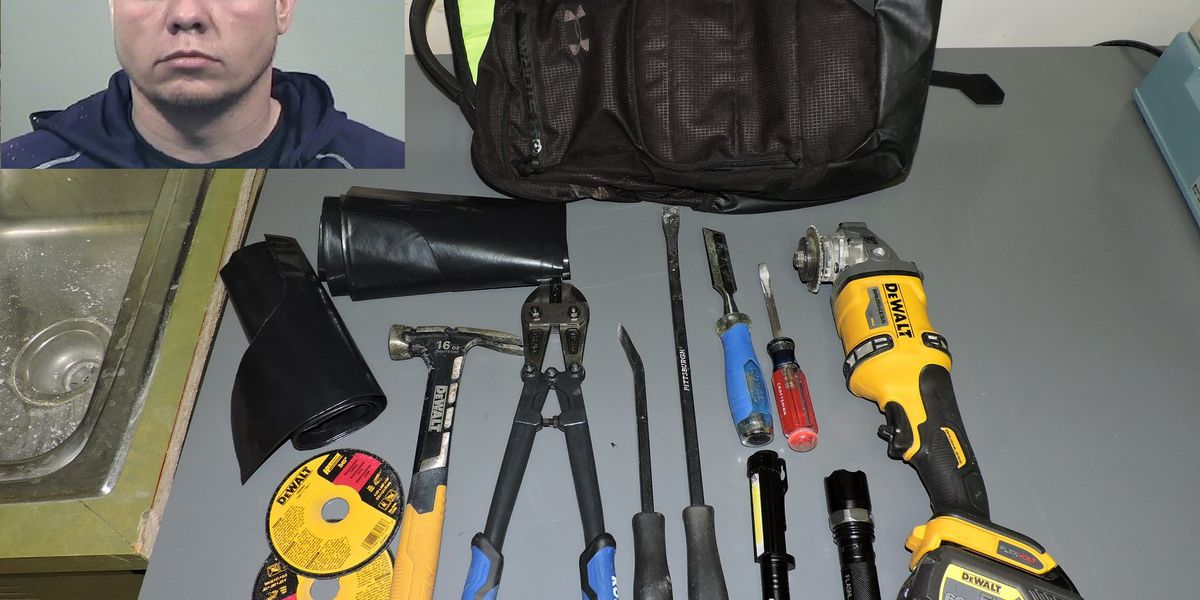 Ohio police catch bank burglary suspect 'red handed' trying to open safe with power tool