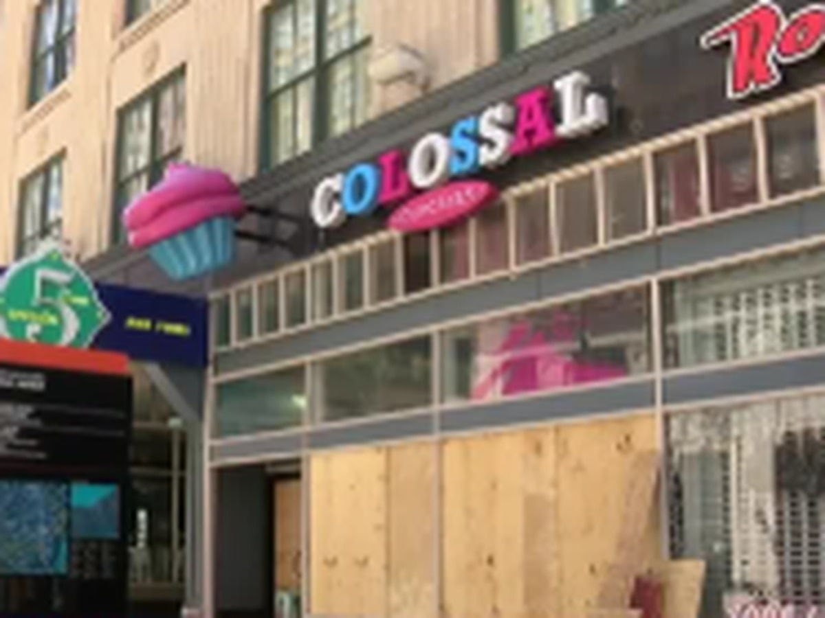 Owner of Colossal Cupcakes explains how her staff ran for safety during Saturday's protest