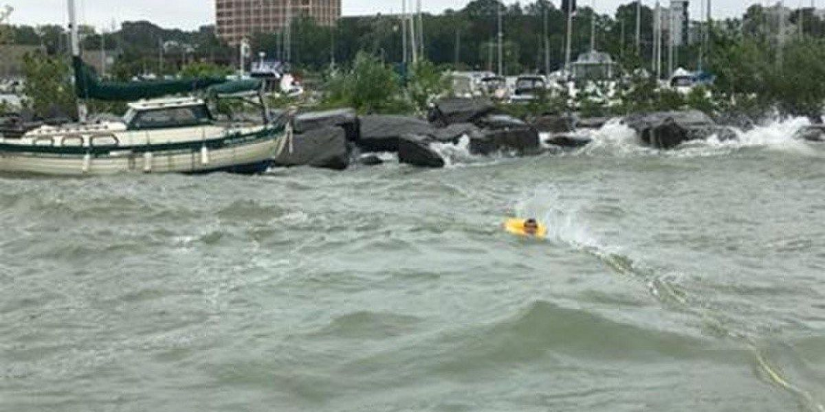 Coast Guard rescues 3 people after a boat hits breakwall in Cleveland