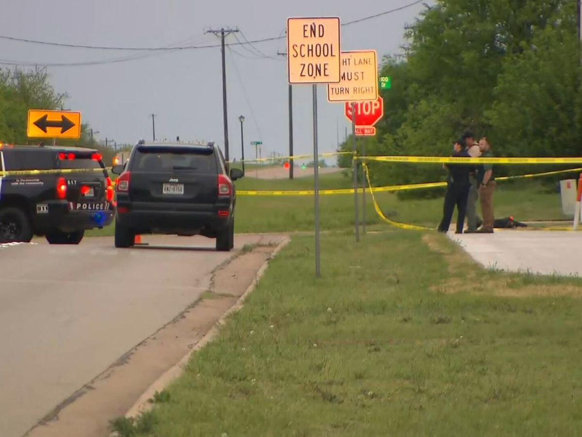 1 arrested, 1 sought in connection to Texas officer shooting