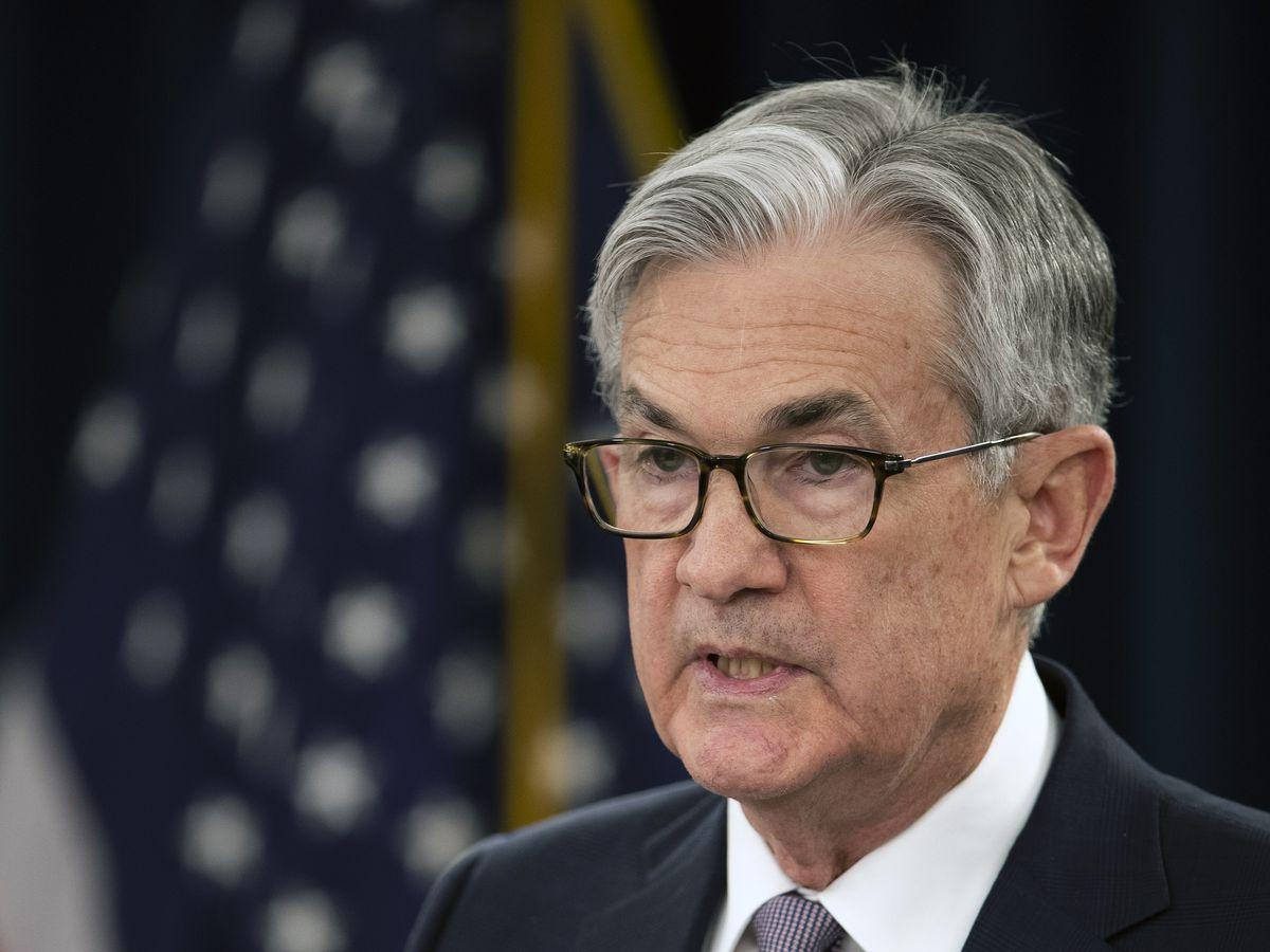 Fed leaves key rate alone but sees coronavirus among global risks