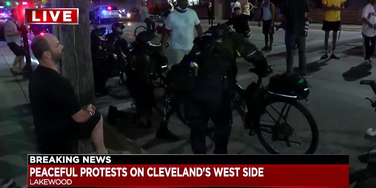 Lakewood Police kneel with peaceful protesters on Detroit Avenue