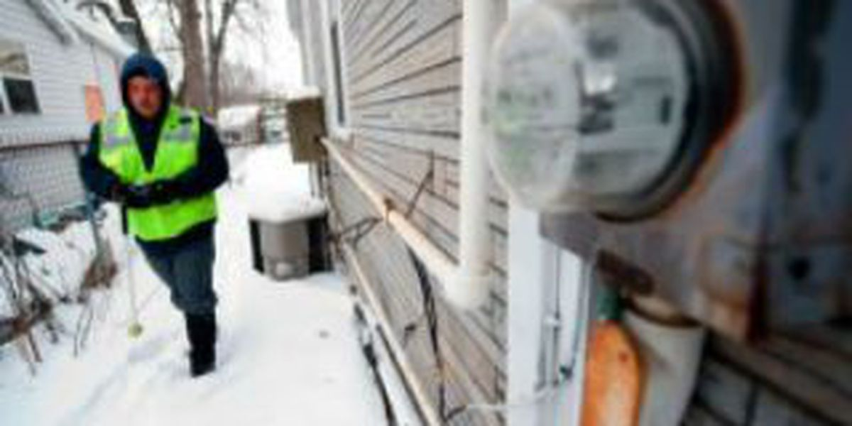 Meter readers battle freezing temps and snow to work outdoors