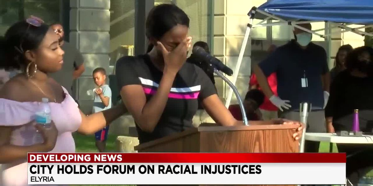 Hundreds of people gather in front of Elyria City Hall to listen to people of color share their experiences with racism