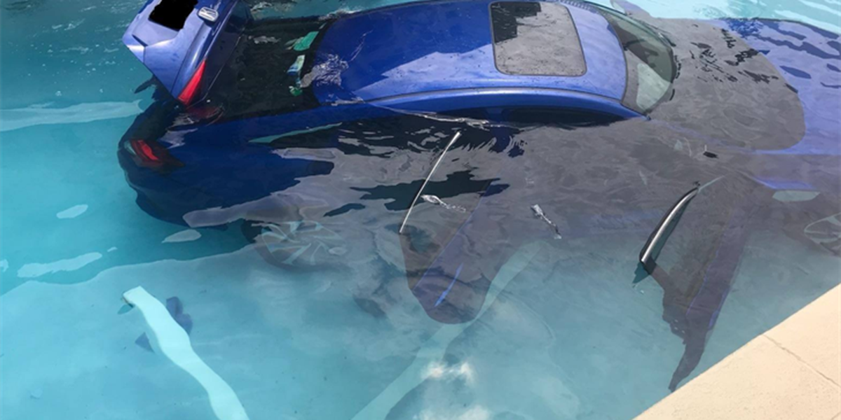 Car ends up in pool after driver doesn't put Honda Accord in park