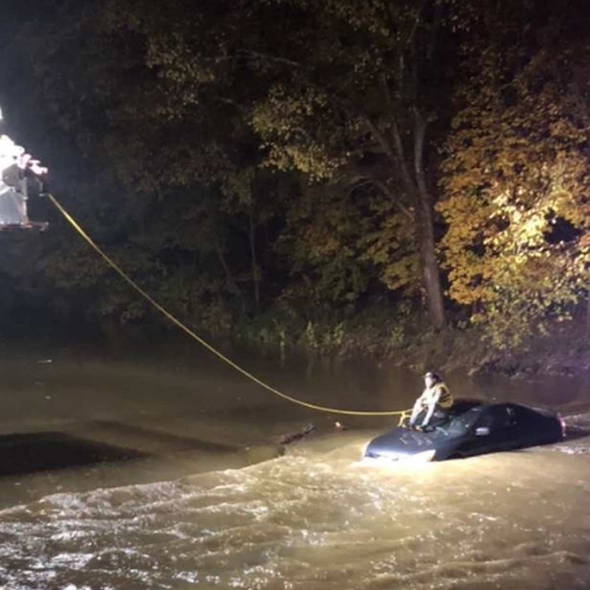Driver stranded by high water rescued from top of car by North Olmsted firefighters