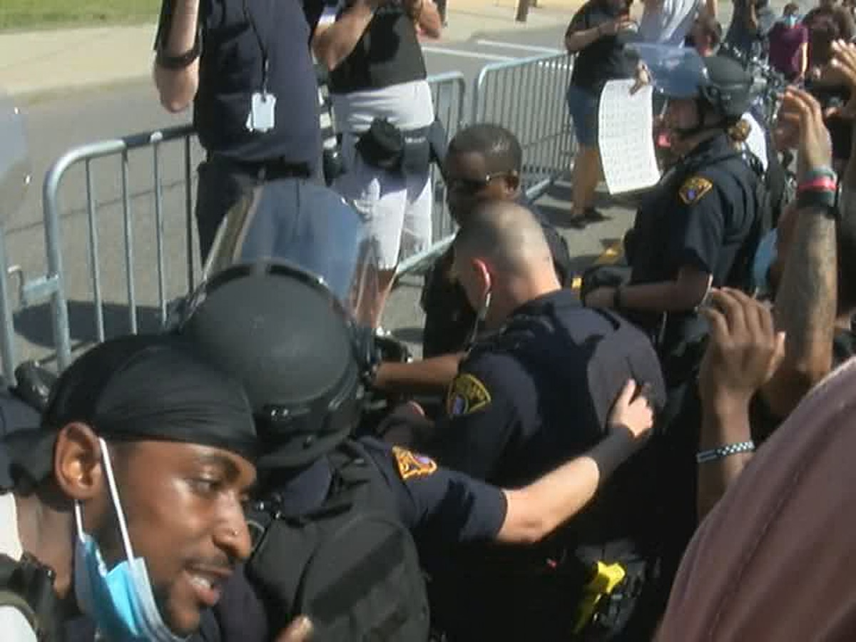 Cleveland police kneel with protesters in support of George Floyd on city's West Side