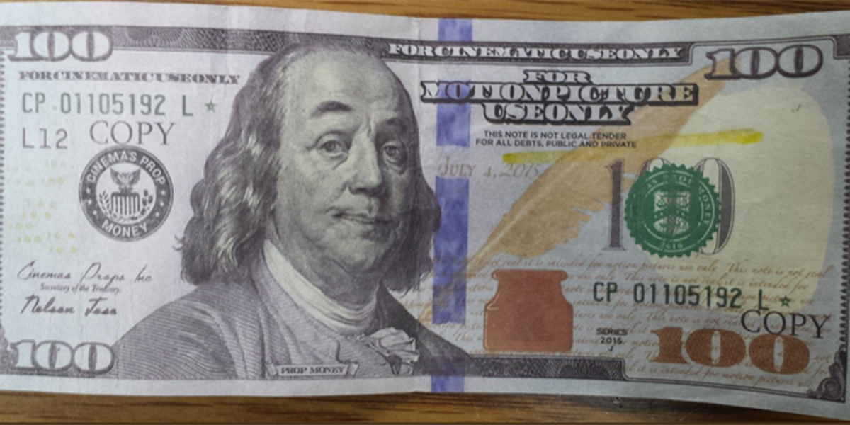 Fake $100 bill caught at Wakeman gas station, displays 'copy' on front and back