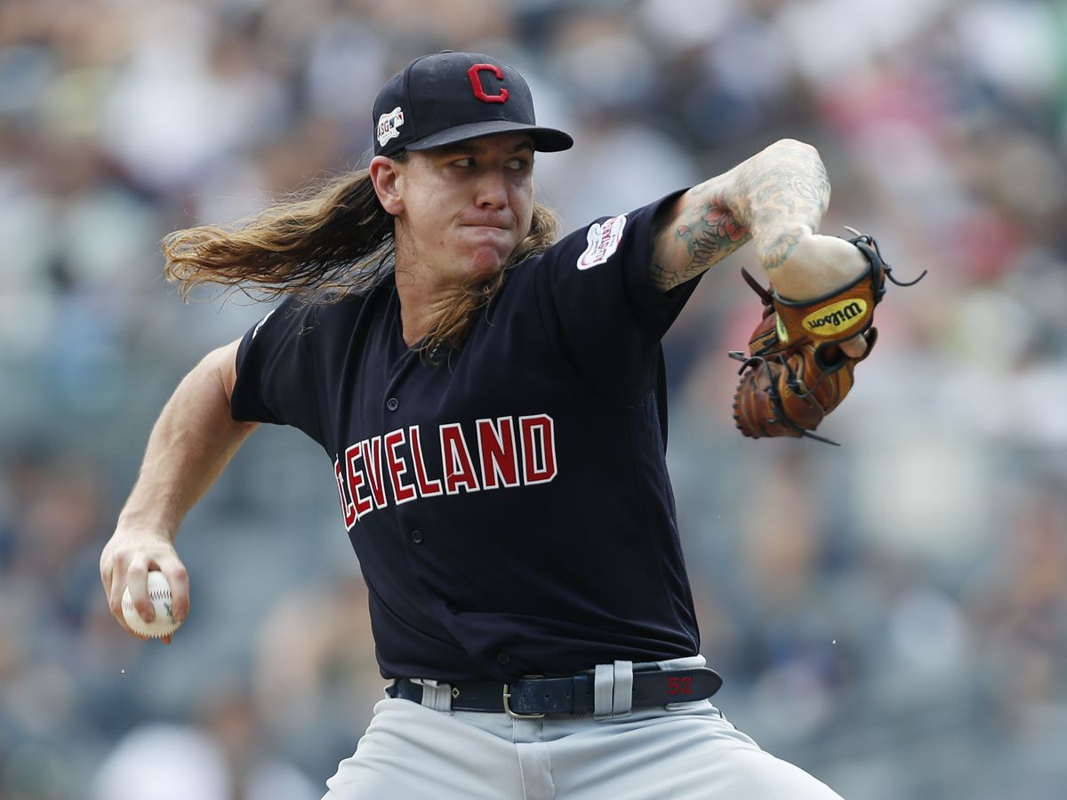 Cleveland Indians pitcher Mike Clevinger now in visitor's locker room ... in a mask