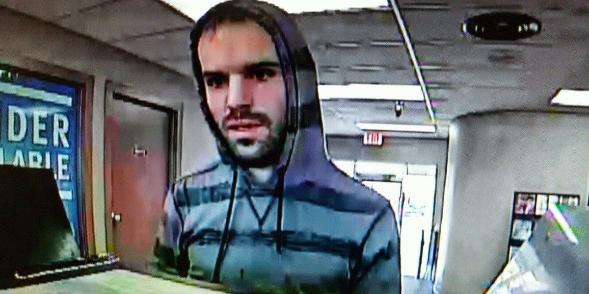 Bold bank robbery suspect gets away with cold hard cash