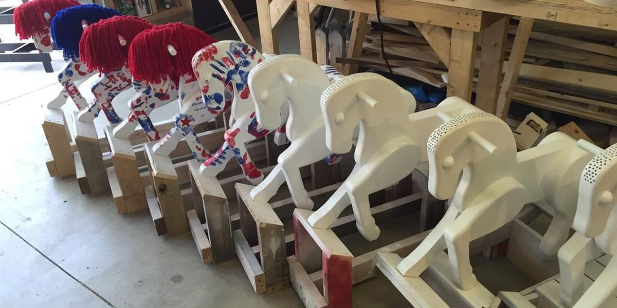 Manuta Couple making rocking horses memorializing fallen soldiers