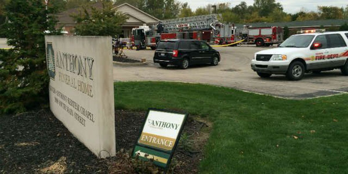Crews battle fire at Akron funeral home