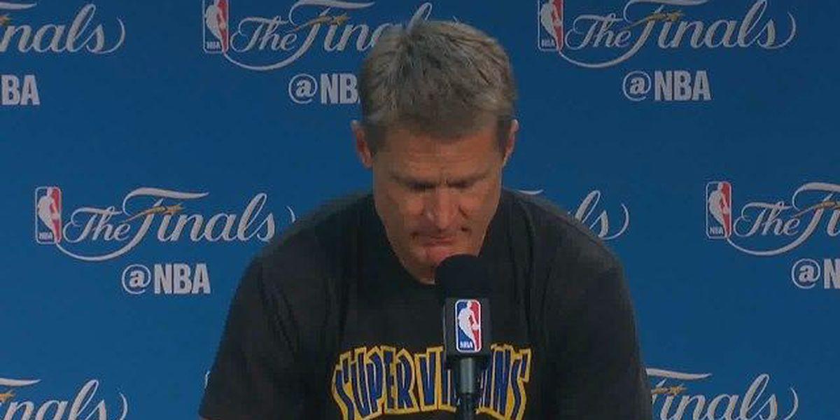 Steve Kerr wears a Supervillains shirt at press conference