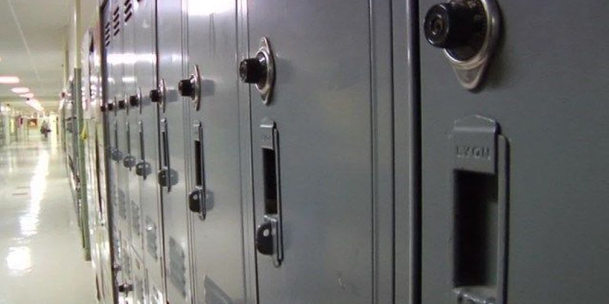 Teacher accused of shoving student into locker