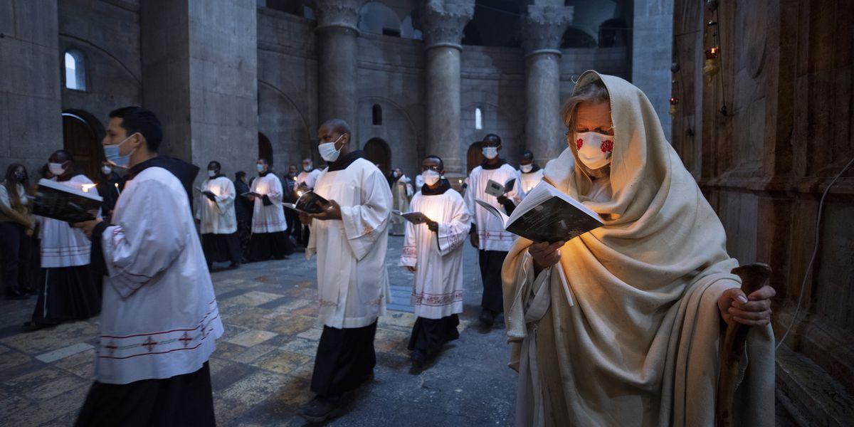 Singing hymns through masks, Christians mark pandemic Easter