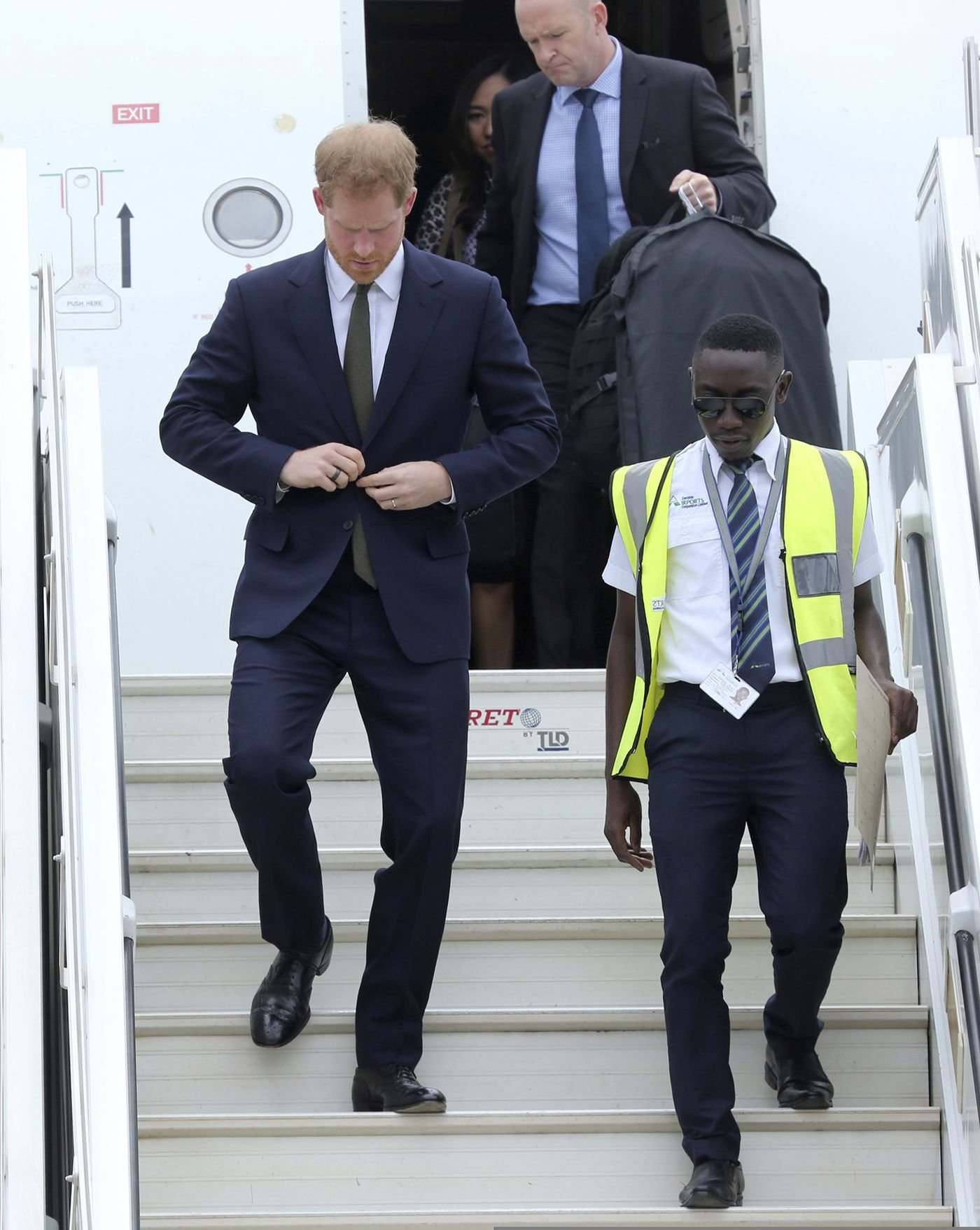 Britain's Prince Harry walks down the plane steps upon his arrival at Kenneth Kaunda airport in Lusaka, Monday, Nov. 26, 2018. Prince Harry is on a State visit to Zambia at the request of the Commonwealth office and is expected to attend various events in the Southern African country. (AP Photo/Tsvangirayi Mukwazhi)