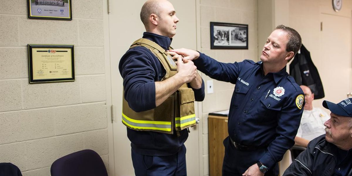 Akron firefighters and medics will start wearing ballistic vests and helmets