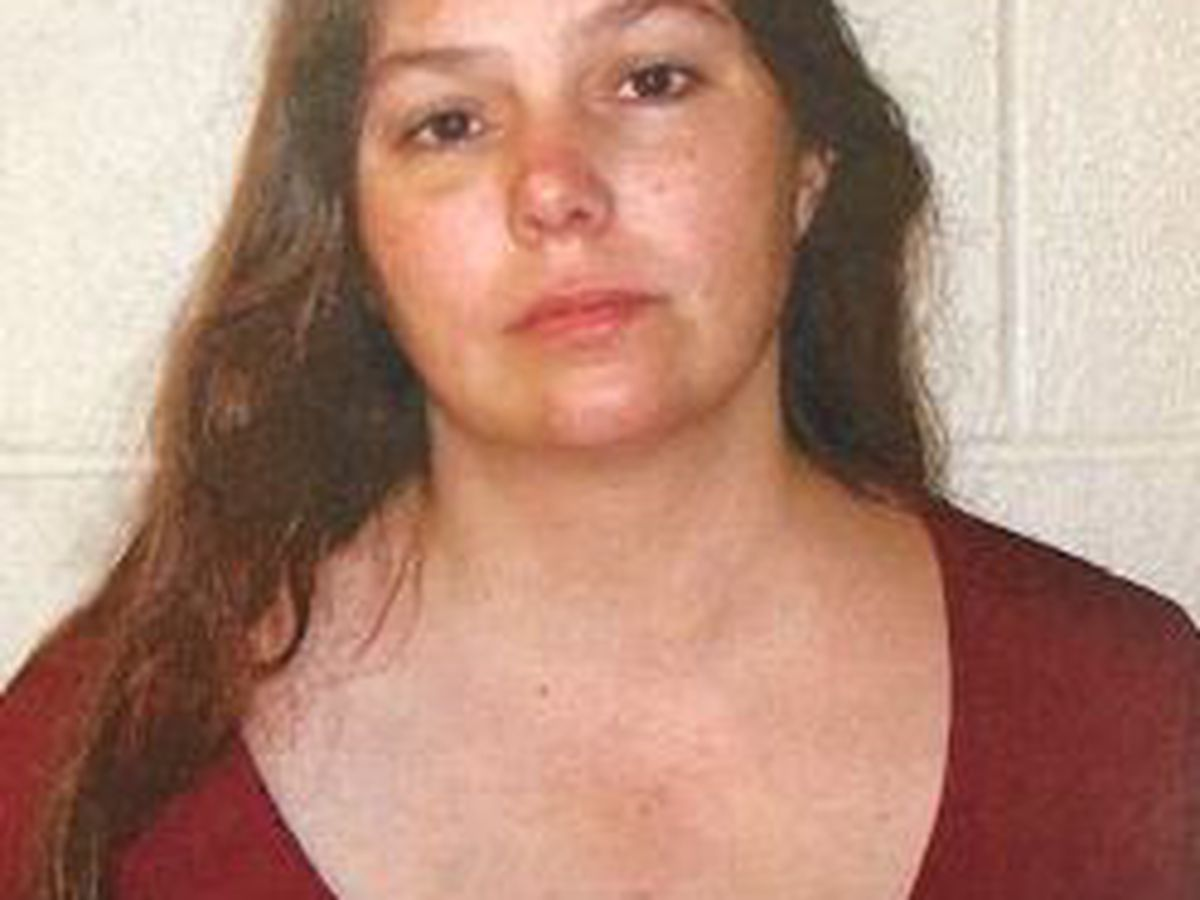 Mother of 4 charged in 2012 Summit County murder