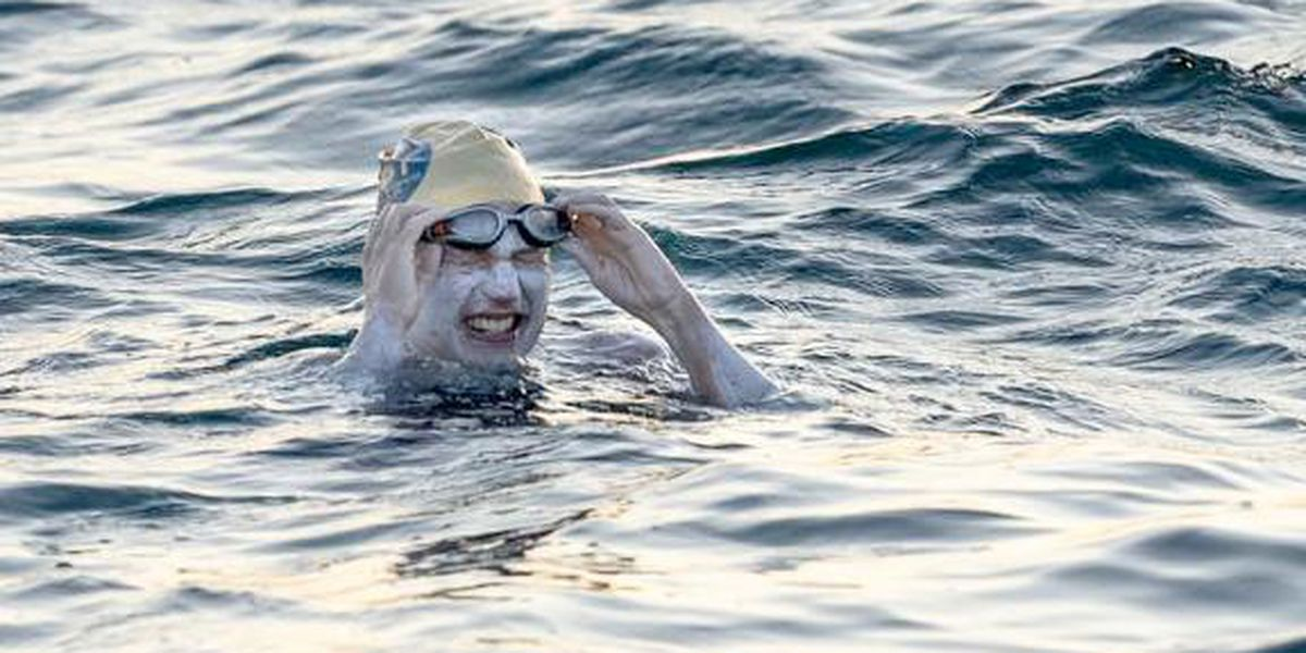 American cancer survivor swims England Channel 4 times, sets world-record