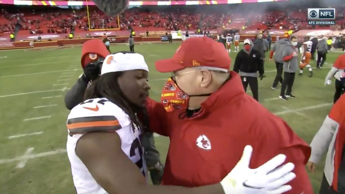 Browns' Kareem Hunt embraces his former head coach after Cleveland falls to Chiefs in AFC Divisional Round