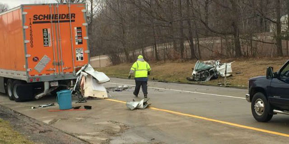 Man hits 2 parked semis in rest stop area, dies