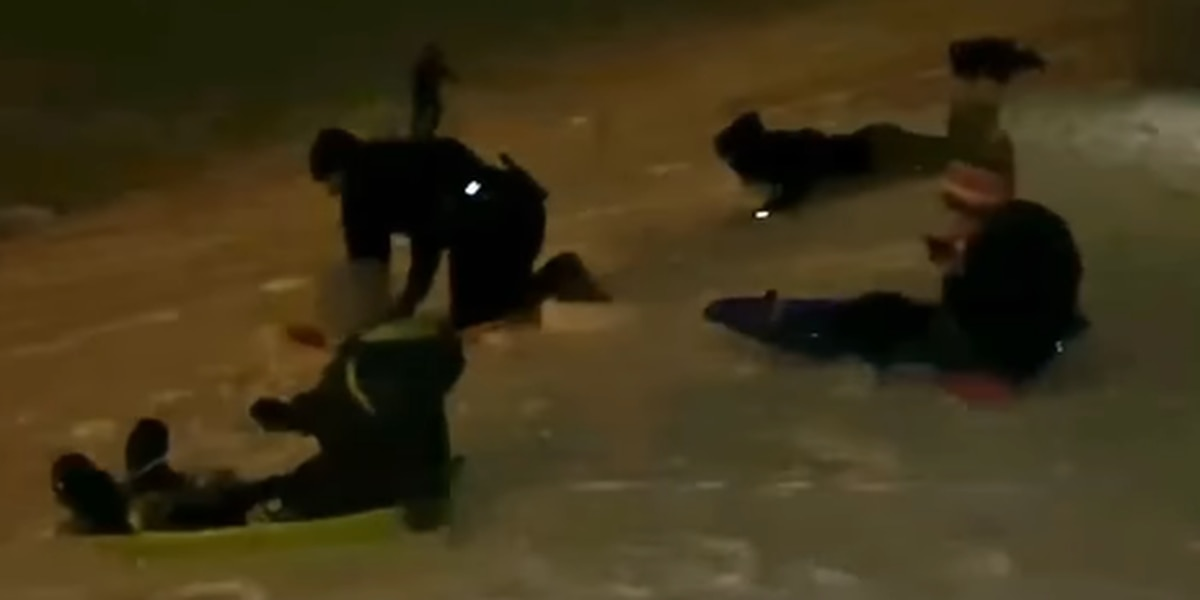 Oberlin patrolman loses sledding race to kids; spreads joy during difficult year (video)