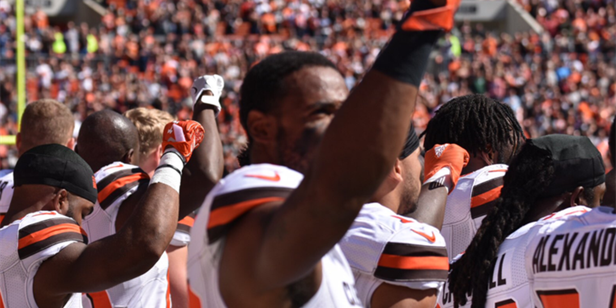 Cleveland Browns players raise fists during national anthem