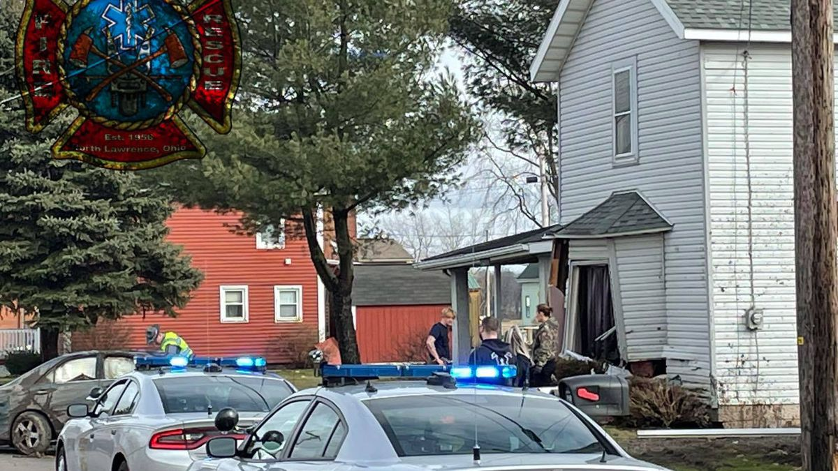North Lawrence: Car flips, strikes residential structure and garage after two-car crash